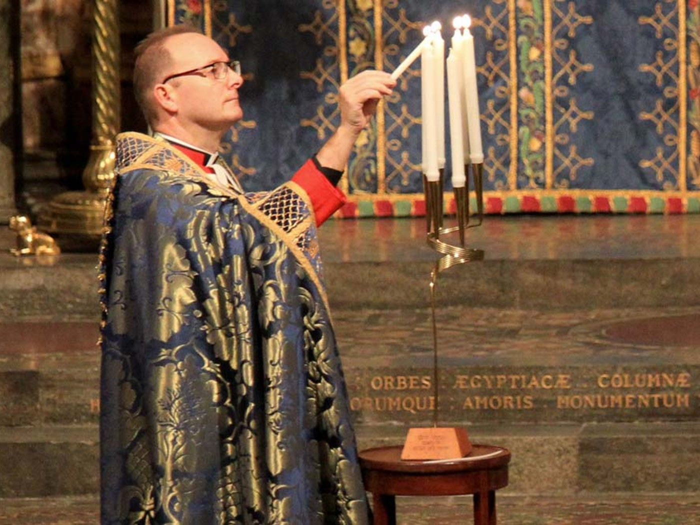 Anthony Ball, Canon in Residence, Westminster Abbey, lights a memorial candle